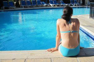 Girl in Blue Bikini by the pool